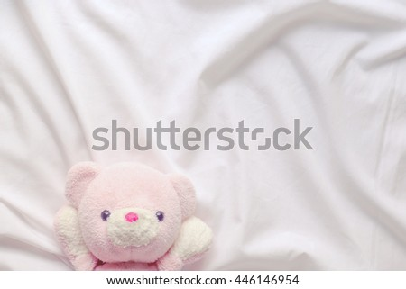 teddy bear on fabric - stock photo