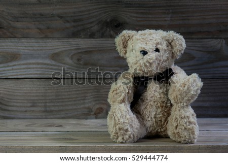 Teddy bear on old wood