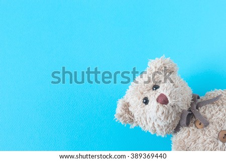 teddy bear on pastel background - stock photo
