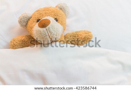 Teddy Bear on the bed. - stock photo