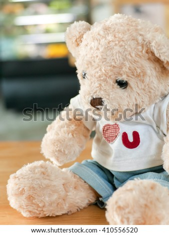 Teddy Bear on the wooden,at cafe background  - stock photo
