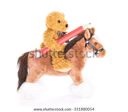 Teddy bear ride a horse and hold pencil on white background - stock photo
