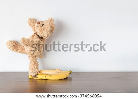 teddy bear slipped banana peel - stock photo