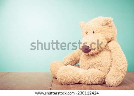 Teddy Bear toy alone front mint green gradient wall background - stock photo