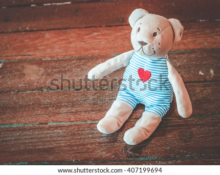 Teddy Bear toy alone on wood.  - stock photo