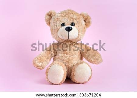 Teddy Bear toy alone with light pink background - stock photo