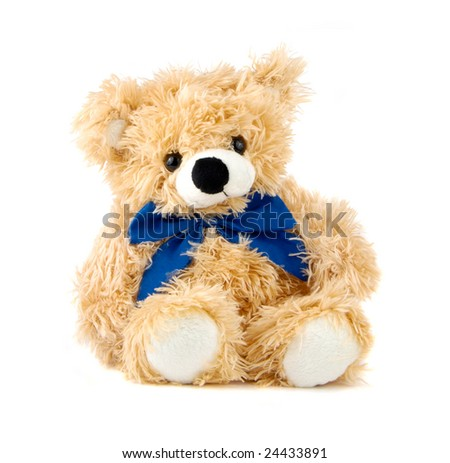 Teddy Bear toy with blue bow isolated over white - stock photo