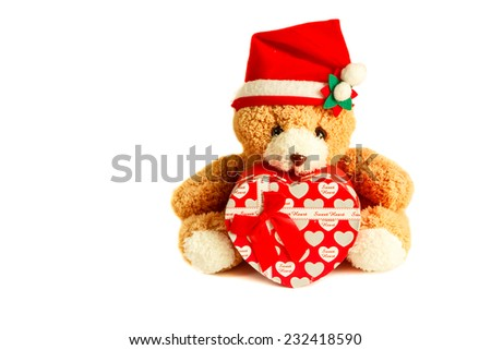 teddy bear wearing a santa hat and gift isolated on white background.