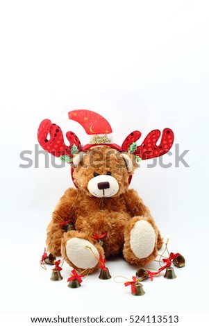 Teddy bear wearing a santa hat and the Xmas Ornaments on white background