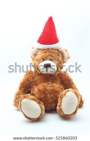 Teddy bear wearing Christmas headband on white background