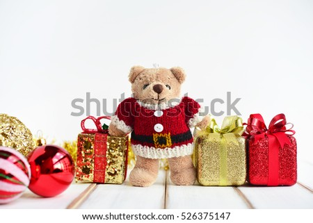 Teddy Bear wearing Santa Claus knitted sweaters with Christmas Gift Boxes.Creative for colorful greeting card with copy space. Merry Christmas