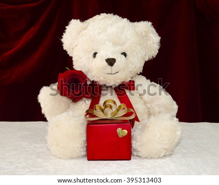 teddy bear with a red rose