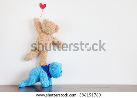 Teddy bear with balloon - stock photo