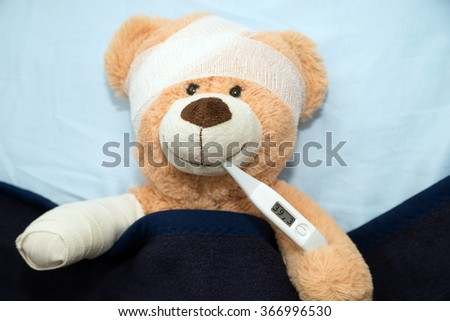 Teddy Bear with Bandage and Clinical Thermometer / sick Teddy