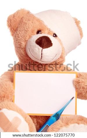 Teddy Bear with Bandage and empty Sign / Teddy Bear - stock photo