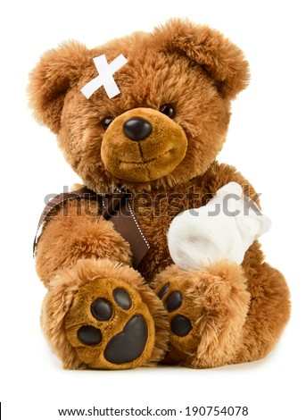 Teddy bear with bandage isolated on white background - stock photo