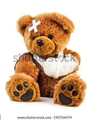 Teddy bear with bandage isolated on white background - stock photo