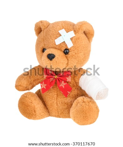 Teddy bear with bandage isolated on white, without shadow. - stock photo