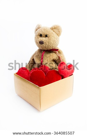 Teddy bear with big red heart isolated over white background
