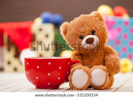 Teddy bear with cup of coffee or tea on christmas background