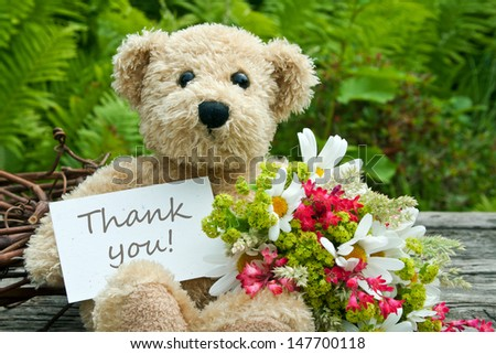 teddy bear with flowers and card with lettering thank you/thank you/teddy