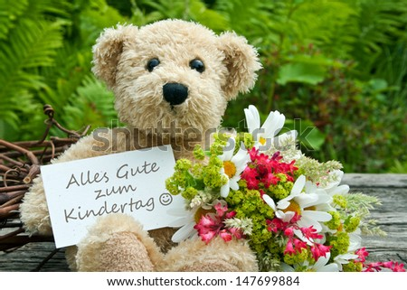teddy bear with flowers and children`s day card/children`s day/teddy