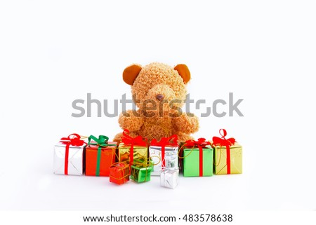 teddy bear with gift boxes isolated on white background.teddy bear enjoy with gift boxes.teddy bear playing gift boxes.teddy bear and gift boxes for kids