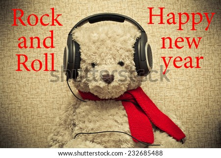 Teddy bear with headphones.Rock and roll and a happy new year  - stock photo