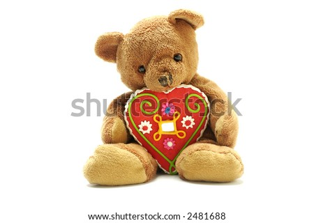 Teddy bear with heart isolated on white