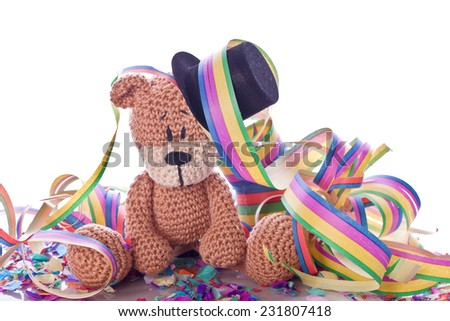 teddy bear with paper streamers and confetti on new years eve - stock photo