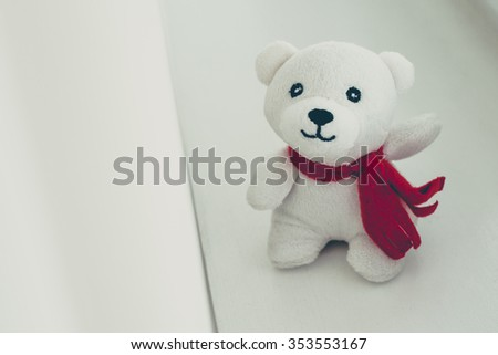 Teddy bear with red bow .