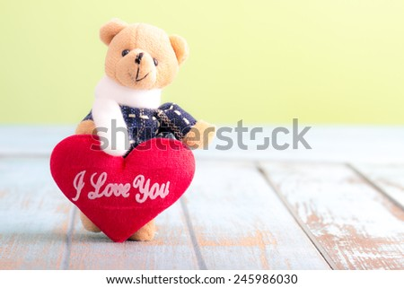 Teddy Bear with Red Heart on wooden table for valentine day - stock photo