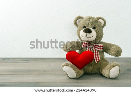 Teddy Bear with red heart. Valentines Day concept. Old toys