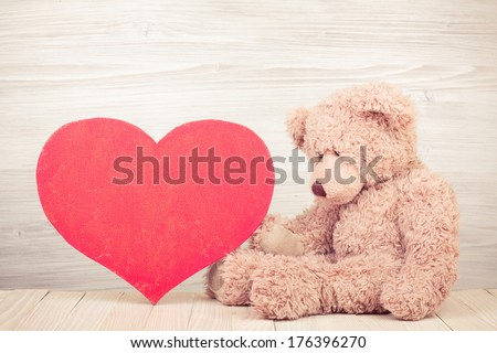 Teddy Bear with red Love heart - stock photo