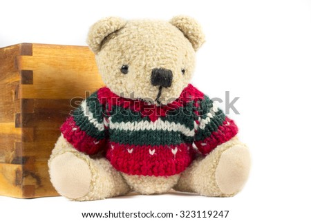 Teddy bear with red wool coat, on white