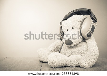 Teddy Bear with retro headphones. Vintage old style sepia photo - stock photo