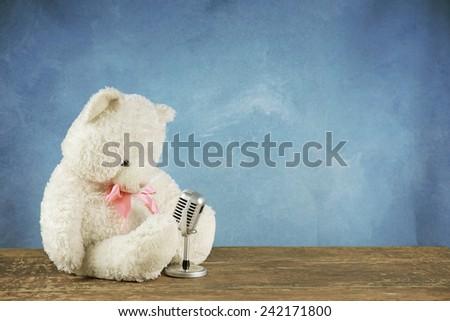 teddy bear with retro microphone - stock photo
