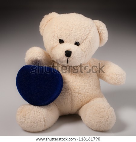 Teddy bear with romantic gift - stock photo