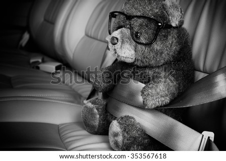 Teddy bear with safety belt,Safety concept black and white - stock photo