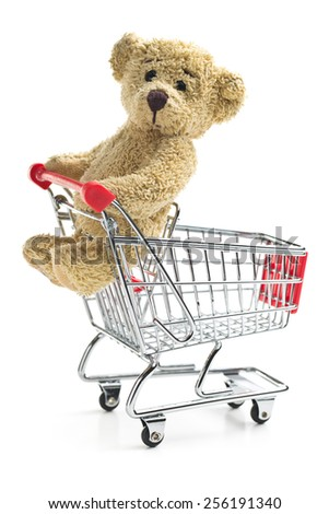 teddy bear with shopping cart - stock photo