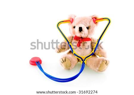 Teddy bear with stethoscope on white background - stock photo