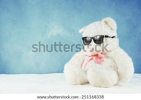 teddy bear with sun glass - stock photo