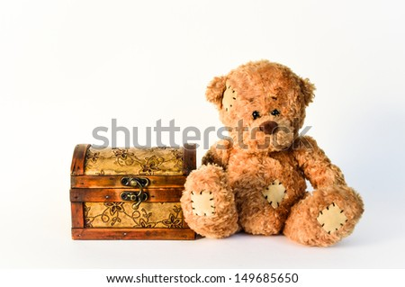 Teddy bear with treasure chest Maybe with a treasure in it or not - stock photo