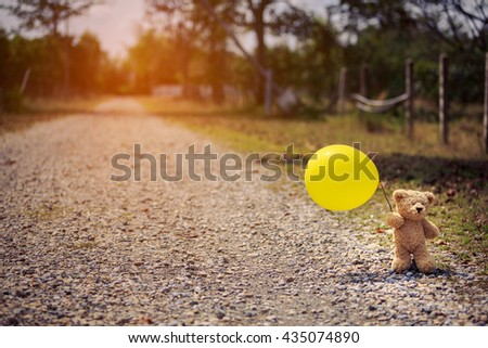 teddy bears and balloon on the road,felling lonely,vintage filter - stock photo