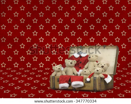 teddy bears in a suitcase textured background - stock photo