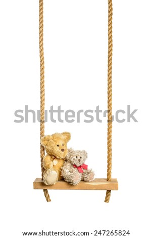 Teddy bears on rope swing isolated on a white background - stock photo