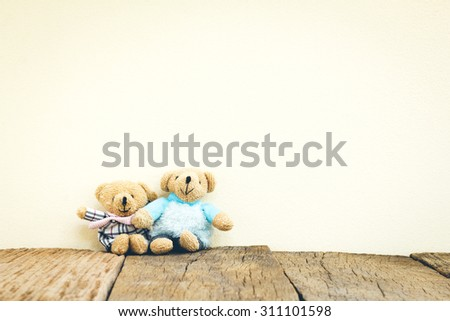 Teddy Bears toy on wood in front concrete background - stock photo