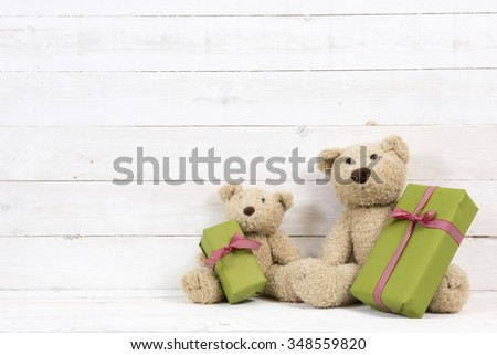 teddy bears with presents  - stock photo