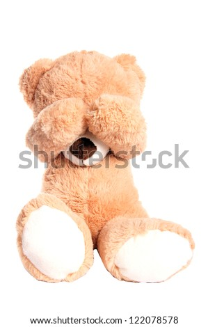 Teddy covers her eyes / Teddy - stock photo