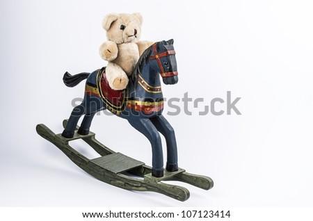 Teddybear and rocking horse - stock photo